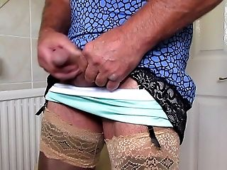 Pleated miniskirt and nylon slip wank